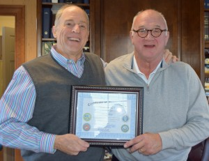 "Tim Furlow (right) receives a Certificate of Appreciation by Quimby Melton, for his service as 2015 Honorary Chair of Honor our KIA. In making the presentation, Melton said, ""We could not have accomplished what we have without Tim's dynamic leadership. Tim is an outstanding example to all of us in Griffin and Spalding County of what true dedication, patriotism and a hometown hero is all about."""